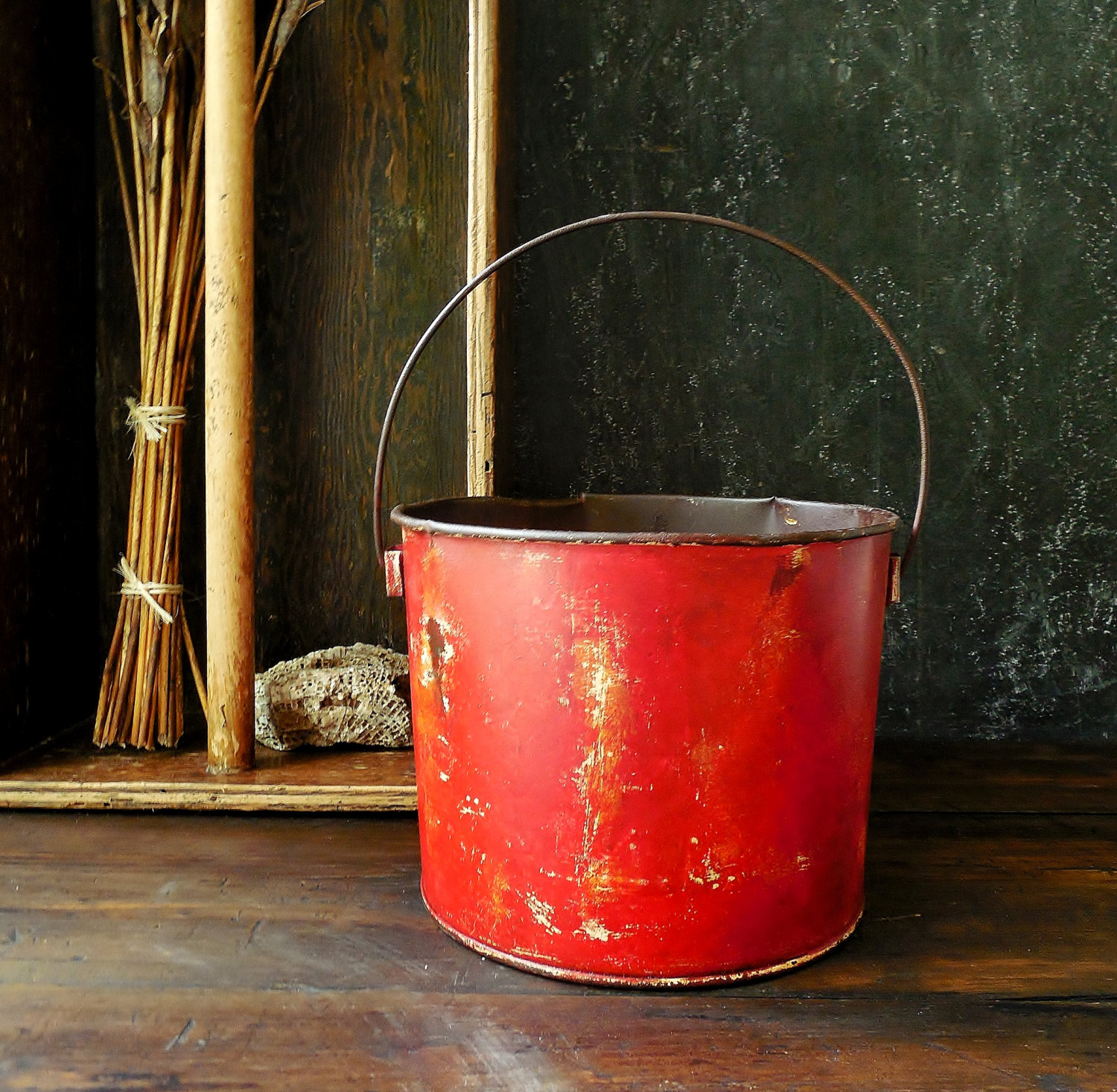 old red farm bucket